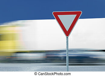 Give way yield traffic sign and truck