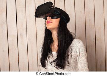 Woman in VR glasses - Woman in virtual reality helmet. VR...