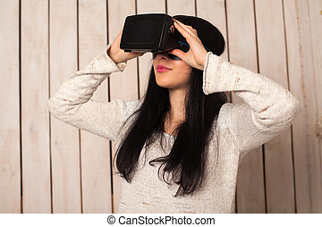Woman in VR glasses - Woman in virtual reality helmet. VR...