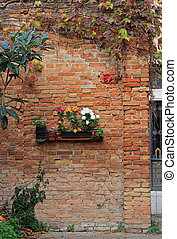 the brick wall with flowerbed