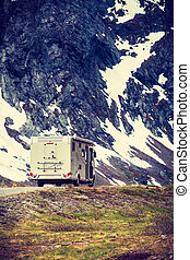 Camper car in norwegian mountains - Tourism vacation and...