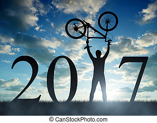 Forward to the New Year 2017 - Cyclist with bicycle at...