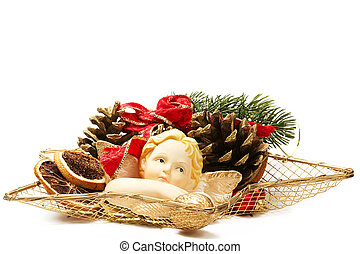 christmas plate arrangement with angel figurine on white background