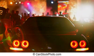 Car party - Beautiful sports car is in the center of night...