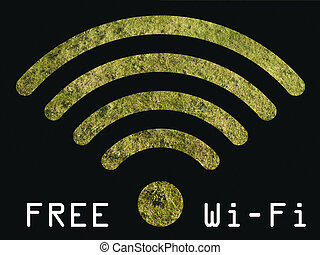 Free WIFI sign with grass visible through graphics on black...