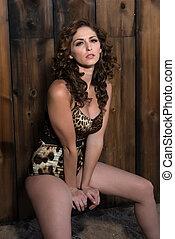 Brunette in a bodysuit - Beautiful shapely brunette in a...