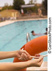 Woman´s hands holding a lifesaver float - Woman catching...