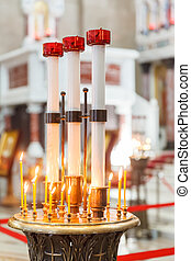 Naval cathedral of Saint Nicholas in Kronstadt - candles and...