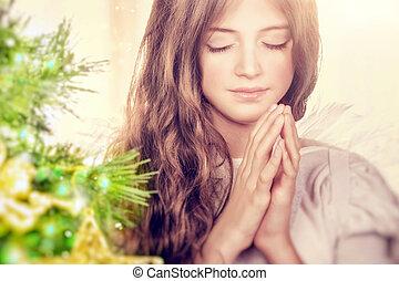 Beautiful angel praying - Closeup portrait of a beautiful...