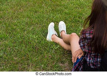 Woman feet on grass.
