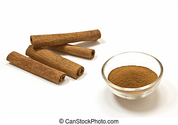Cinnamon sticks and ground cinnamon isolated on white...