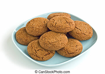 Ginger snaps - Freshly baked ginger snaps on pale blue plate...