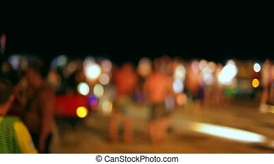Party on the beach - A large group of people dancing under...