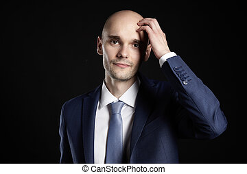 Man Scratching his Head - Studio shot of young businessman...