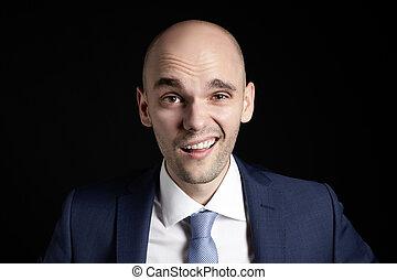 Unbelievable on young businessman face. Portrait on black...