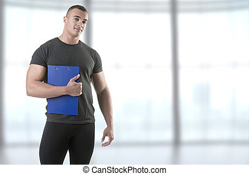 Personal Trainer, with a pad in his hand