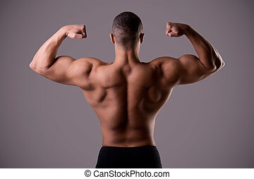 Back Double Biceps Pose - Bodybuilder doing a Back Double...