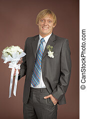 Happily smiling groom with bunch - Happily smiling groom...