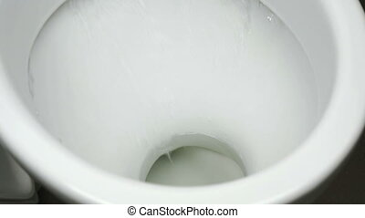 Close up view of flushing white toilet