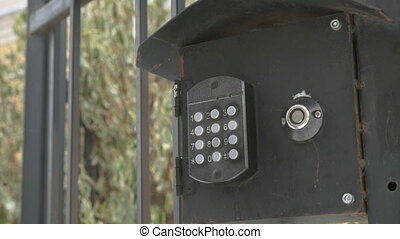 Hand dials number of apartment on intercom system - Person's...
