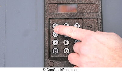 Modern digital intercom system mounted outdoors - The modern...