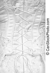 Lacing on a corset - rear view - Lacing on a corset of a...