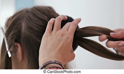 2 shots. Professional hairdresser doing hairstyle for young...