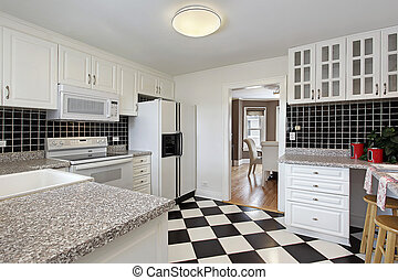 Kitchen with checkerboard floor - Kitchen in suburban home...