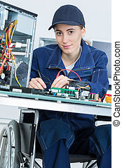 Portrait of disabled computer technician
