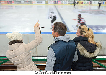 cheering a game of ice hockey