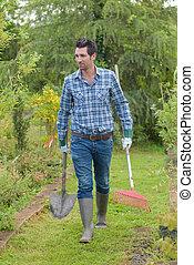 bringing spade and rake