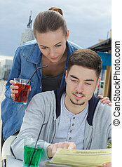 young couple with soft drink