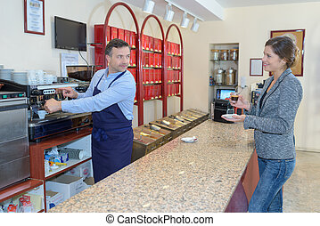 Waiter using coffee machine