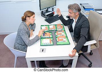Executives discussing housing development