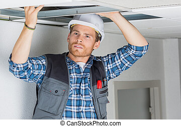 electrician fitting a cable for ceiling light