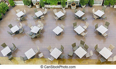 Outdoor top view of the empty chairs and table.