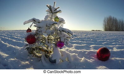 Beautiful Christmas tree with bauble on snowy new year...