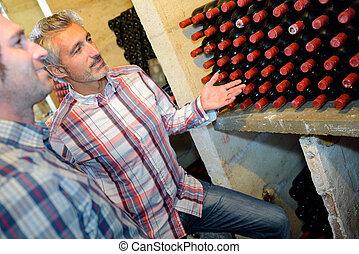 sommelier showing bottle of wine