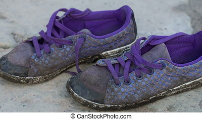 Old sneakers on the ground - Old dirty sneakers on the floor