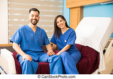 Male and female nurses relaxing at work - Portrait of a good...