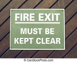 Vintage looking Fire exit sign with white text over green