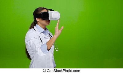 Training using virtual reality glasses. Medicine - Woman...