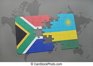 puzzle with the national flag of south africa and rwanda on...
