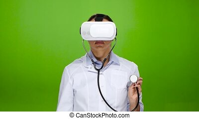 Woman doctor studies with the help of virtual reality...
