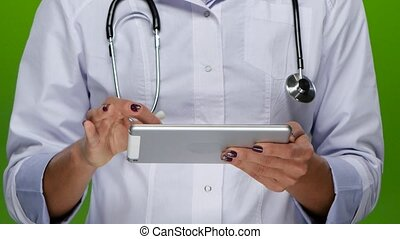 Woman hands doctors work on the tablet pc. Close up - Woman...