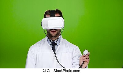Doctor wearing virtual reality glasses conducts research...