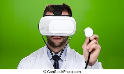 Man doctor wearing virtual reality glasses conducts research...
