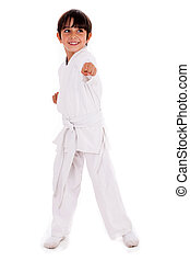 Small karate boy in training isolated white background