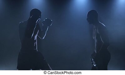Work on the blows of two boxers in a studio - Two boxers in...