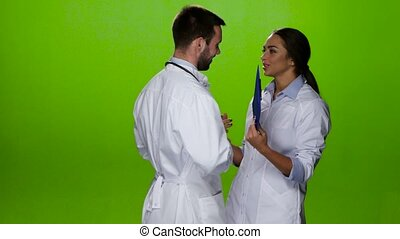 Two met the doctors and talk about the patients. Green screen